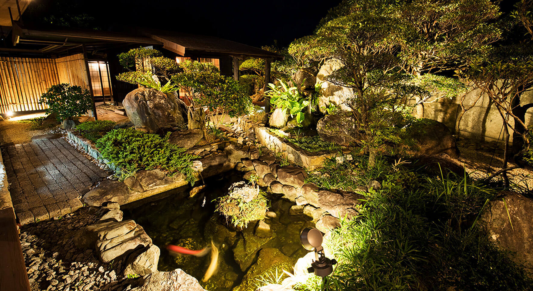 The grandiose Japanese-styled garden with tropical plants